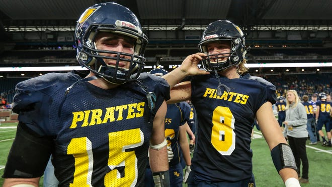 Pewamo-Westphalia quarterback Jimmy Lehman, right, and running back Bryce Thelen celebrate after defeating Saugatuck 21-0 at the MHSAA Division 7 championship game at the Ford Field in Detroit, Saturday, November 25, 2017.