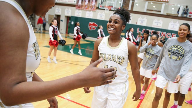 Warren Central Warriors Cydni Dodd (50) and Sheila Beeler (10) celebrate the team defeated the North Central Panthers in sectional finals at Lawrence North High School in Indianapolis, Ind., Saturday, Feb. 3, 2018. Warren Central won, 66-54.