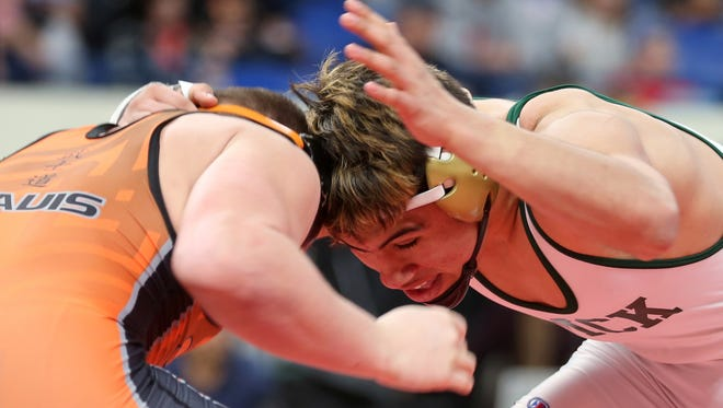 McKay's David Rubio, right, and Sprague's Landon Davis compete in the OSAA Wrestling State Championships Class 6A final for weight 170 at Veterans Memorial Coliseum in Portland on Saturday, Feb. 17, 2018. Rubio was the champion.