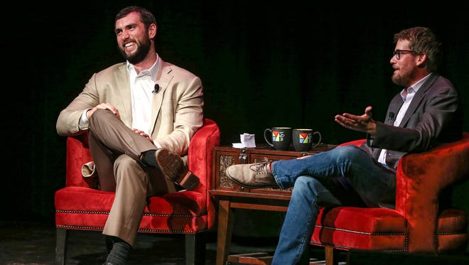 Andrew Luck, left, and John Green talk about books Thursday at the Egyptian Room in Old National Centre.