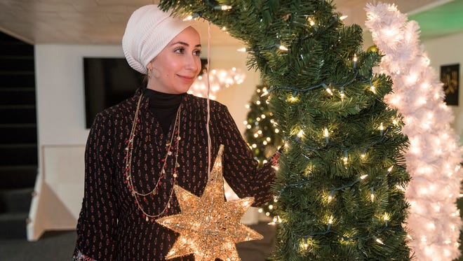 Samar Baydoun Bazzi poses for a photo with a finished Ramadan trees at her home in Dearborn, Thursday, May 3, 2018.