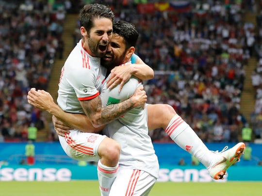 Spain's Diego Costa, right, celebrates with his teammate Isco after scoring his side's opening goal during the group B match between Iran and Spain at the 2018 soccer World Cup in the Kazan Arena in Kazan, Russia.