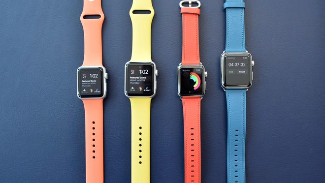 (FILES) This file photo taken on March 21, 2016 shows Apple watches with new band colors  seen on display during a media event at Apple headquarters in Cupertino, California. Wearable tech, which was seeing sizzling sales growth a year ago, is cooling this year amid consumer hesitation over new devices, a survey showed September 15, 2016. The research firm IDC said it expects global sales of wearables to grow some 29.4 percent to some 103 million units in 2016.That follows 171 percent growth in 2015, fueled by the launch of the Apple Watch and a variety of fitness bands.  / AFP PHOTO / Josh EdelsonJOSH EDELSON/AFP/Getty Images ORIG FILE ID: AFP_G678R