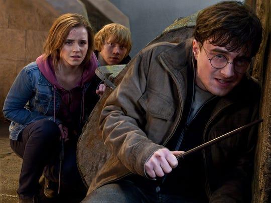 Emma Watson, Rupert Grint and Daniel Radcliffe in scene