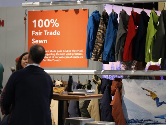 In this Wednesday, Jan. 30, 2019, photograph, a sign indicating items that were 100-percent fair trade-sewn marks a rack of jackets and shells in the Patagonia exhibit at the Outdoor Retailer & Snow Show in the Colorado Convention Center in Denver.