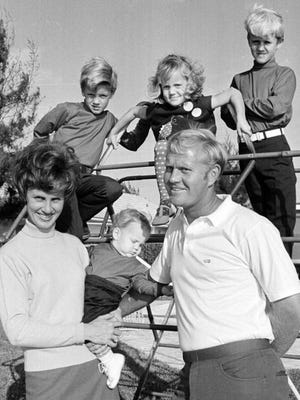 Golfer Jack Nicklaus poses for this family portrait in the backyard of his North Palm Beach home Nov. 19, 1969. His wife, Barbara, holds son Gary, 10 months old. On the jungle gym are (from left) Steven, 6; Nancy Jean, 4; and Jackie, 8.