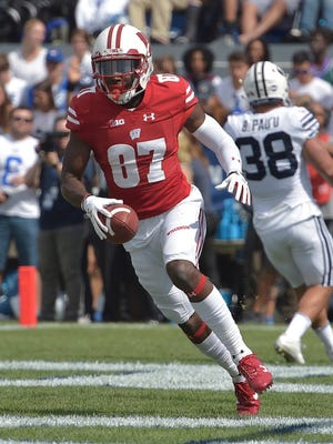 Quintez Cephus celebrates one of his two touchdown receptions during the second quarter for the Badgers in their victory over BYU on Saturday.