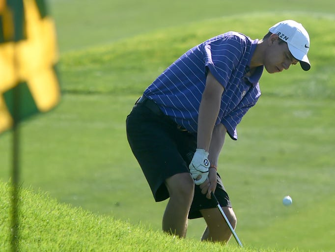 Fort Collins golfer, A.J. Ott, hits a chip shot onto the green during the Front Range League Championships at Harmony Club golf course Monday Sept. 2, 2014.