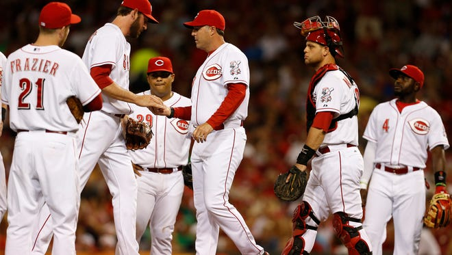 Reds manager Bryan Price takes relief pitcher Logan Ondrusek out of the game May 24.