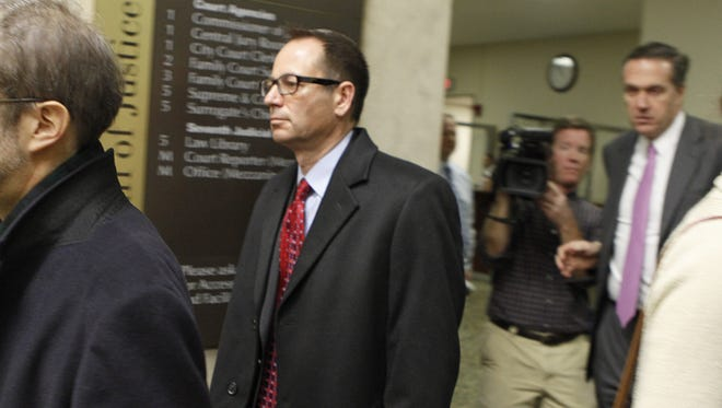 Defendant John Maggio, center, leaves court following a hearing in the LDC corruption case in Monroe County Court Wednesday, Dec. 18, 2013.