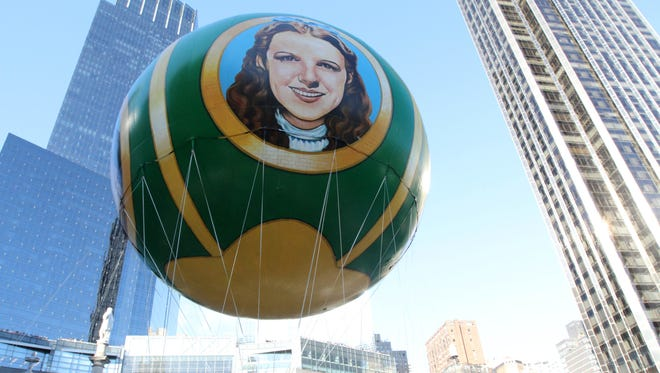 """The Wizard of Oz"" balloon at Thursday's Thanksgiving parade in New York. Singing along to musicals can help cognitive abilities."