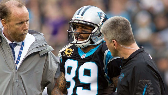 Carolina Panthers wide receiver Steve Smith gets helped off the field after an injury during the first quarter against the New Orleans Saints at Bank of America Stadium.