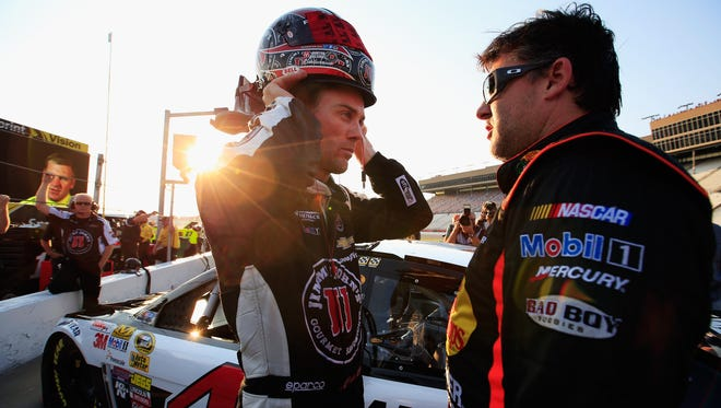 Kevin Harvick, left, will lead the field Sunday, while Stewart-Haas Racing teammate Tony Stewart will start 12th in his return to NASCAR.