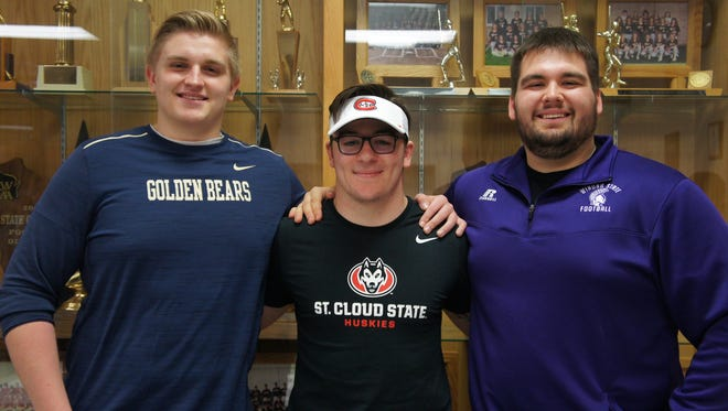 Stratford High School senior football players, Tyson Kauffman, left, Kam Bornbach and Tanner Weinfurtner, signed letters of intent to play football at Minnesota schools.