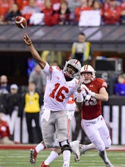 Ohio State quarterback J.T. Barrett throws a pass against Wisconsin in the Big Ten Championship Game.
