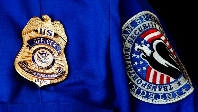 A Transportation Security Administration badge and patch shown June 27, 2008, at Washington's Reagan National Airport.