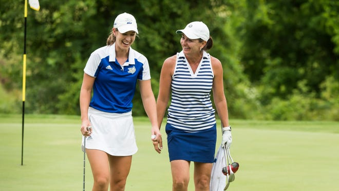 Tori Ross, left, and Amy Kennedy laugh after competing against each other in the Women's York County Amateur Golf Association championship at Honey Run Golf Club in Dover Township on June 20, 2018. Ross defeated Kennedy, the four-time defending champion.