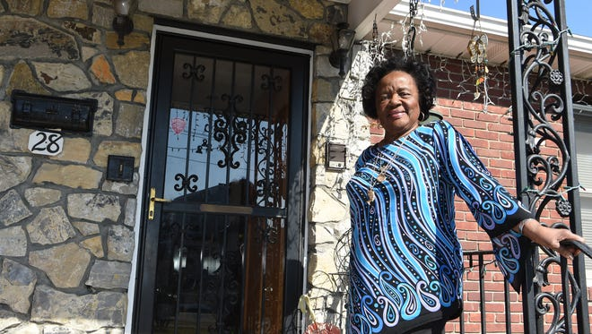 """Perinnella """"Penny"""" Lewis, 88, a retired social worker, stands outside of her home in the City of Poughkeepsie."""