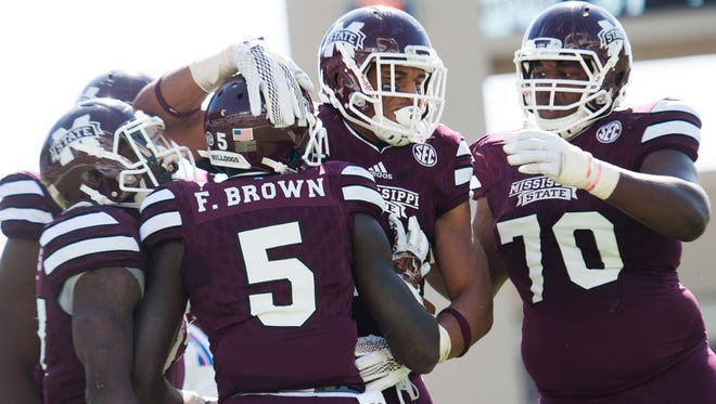 Mississippi State wide receiver Fred Brown (5) celebrates with teammates after scoring a touchdown during the second half of the Bulldogs' Oct. 17 game against Louisiana Tech in Starkville.