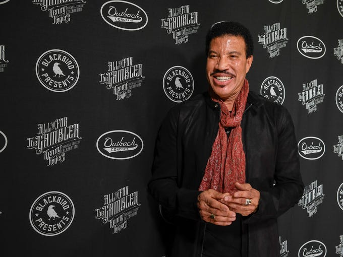 Lionel RIchie poses at the red carpet for the All In