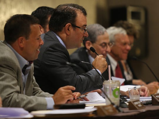 Airmont Mayor Philip Gigante, second from left, speaks during a special board meeting where trustees listen to the public comment on a controversial law banning overnight parking for the entire year at Crowne Plaza, July 5, 2016.The board also voted to create a 'do not knock' registry.