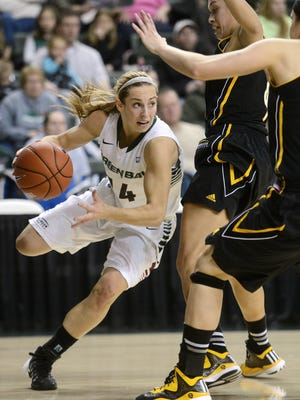 UWGB guard Megan Lukan makes a move around UW-Milwaukee players in the first half at the Kress Events Center.