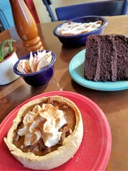 Pastry chef Krista Williams' fall creations are from front: pumpkin pie with pecan streusel, chocolate buttercream cake and bread pudding with bourbon sauce. The pumpkin layer cake with cinnamon cream cheese icing is not pictured.