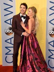 Kelsea Ballerini walks the red carpet with boyfriend, Australian country singer Morgan Evans, at the 2016 CMA Awards on Nov. 2, 2016, in Nashville, Tenn. Ballerini and Evans got engaged during the Christmas holidays after more than nine months as a couple.