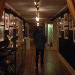 Modern day ghostbusters had this eerie view of the main hallway at the Opelousas Museum and Interpretive Center as they searched for spirits Monday night. At various times the museum building housed the Lafond and Son and Sibille funeral homes.