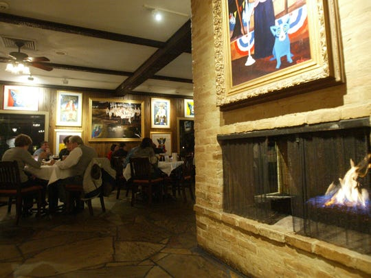 The Blue Dog Cafe is one of several restaurants in Lafayette offering refuge from the cold with fireplace located in the dining area.