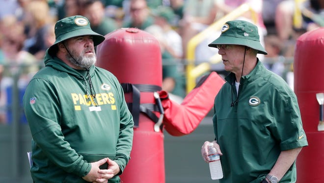 Green Bay Packers head coach Mike McCarthy talks with general manager Ted Thompson during training camp practice on Tuesday, August 29, 2017 at Ray Nitschke Field.