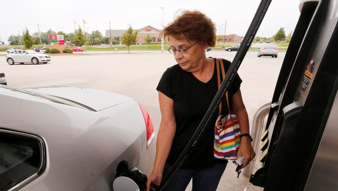 """Chris Hammond fills her tank at the Circle K Friday, September 1, 2017, at 963 Park East Boulevard in Lafayette. Hurrican Harvey has impacted gas prices nation wide, but Hammond isn't upset just yet. """"I would pay more for gas and not be in Texas,"""" she said."""
