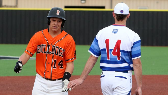 Burkburnett's Wyatt Grant is congratulated by Childress' Silas Finch after hitting a grand slam in the third inning Friday, March 9, 2018, in Henrietta.