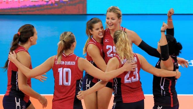 United States players, from left to right, Tetori Dixon, Jordan Larson-Burbach (10), Molly Kreklow, Karsta Lowe (25), Kelsey Robinson (23) and Tamari Miyashiro celebrate their win over Italy.