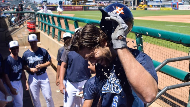 Astros outfielder Jake Marisnick is splashed with water after hitting a home run in the third inning playing for the Hooks on Sunday. Marisnick was in Corpus Christi as part of a rehab assignment.