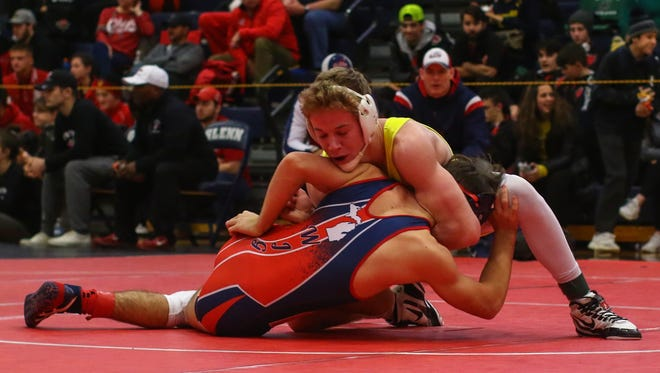 Hartland's Tanner Culver (yellow) will be gunning for an individual district title on Saturday.