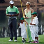 Tiger Woods walks with his children Charlie Woods and Sam Woods and girlfriend Lindsey Vonn on the 4th green during the Par 3 Contest prior to the 2015 The Masters golf tournament at Augusta National Golf Club.