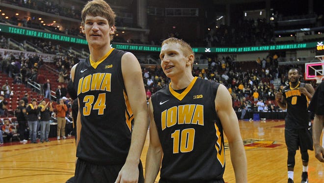 Iowa's #34 Adam Woodbury, left, and #10 Mike Gesell, right, head for the locker room after 83  - 66 win over Drake in the second basketball game of the Big 4 played at Wells Fargo Arena in Des Moines on Saturday Dec. 7, 2013.