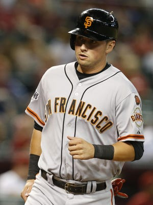 San Francisco Giants' Joe Panik scores a run against the Arizona Diamondbacks in the eighth inning on a ball hit by Buster Posey on Monday.
