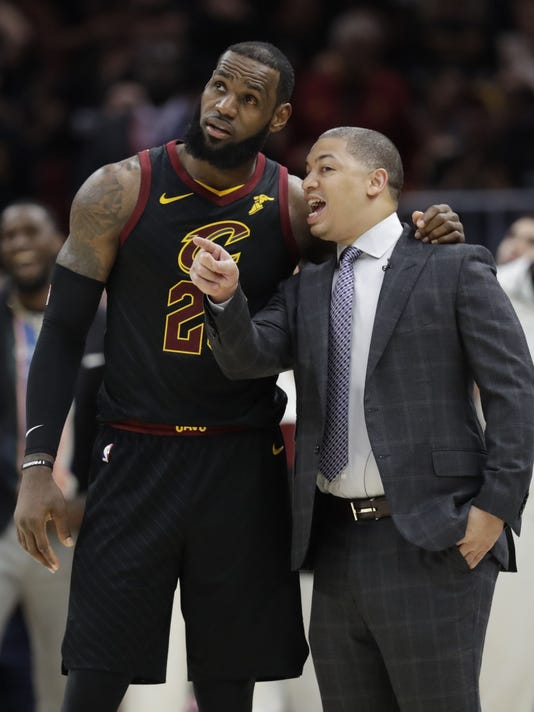 790e96376c9 AP NBA DRAFT LEBRON FACTOR BASKETBALL S BKN FILE USA OH. Cleveland  Cavaliers coach Tyronn Lue talks with LeBron James during ...