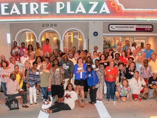 Members of the Vero Beach High School Class of 1978 pose outside the Florida Theatre June 29, 2018, as part of their 40th reunion.