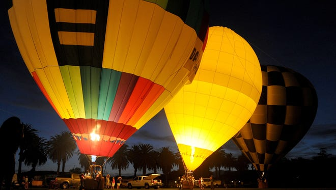The night glow is shown at the 2014 Citrus Classic Balloon Festival in Santa Paula. A smaller event is being planned this year after the original festival was canceled in 2015.