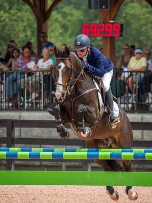 A rider competes in the Grand Prix during the fall 2014 series at Tryon International Equestrian Center.