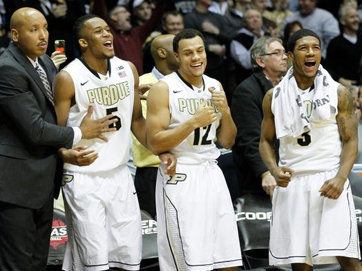 The Purdue bench erupts after A.J. Hammons was fouled with 1.1 seconds remaining and the score tied 64-64 with Penn State Saturday, January 18, 2014, in Mackey Arena on the campus of Purdue University. Hammons hit the first of two free throws to seal the victory for Purdue 65-64 over Penn State.
