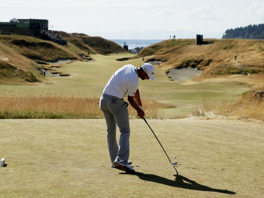 Dustin Johnson hits his tee shot on the 10th hole during the final round of the U.S. Open at Chambers Bay on Sunday in University Place, Wash. Johnson missed two putts on the 18th hole to end his chances of winning.