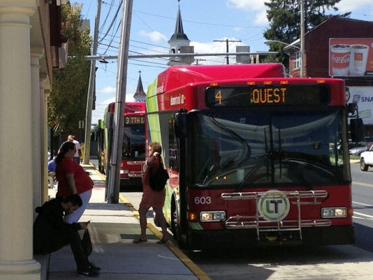A rider exits a Lebanon Transit bus at the transfer station at Seventh and Willow streets in this photo taken last September.