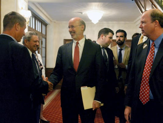 Gov. Tom Wolf greets people before a Rotary Club of York meeting on Wednesday. Wolf, a York County Democrat, joked about all the friendly faces in the crowd.