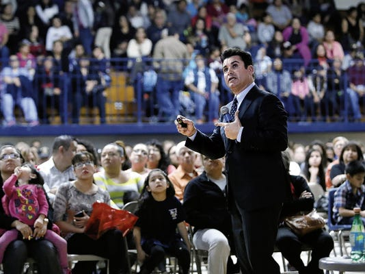 MARK LAMBIE—EL PASO TIMES  Ysleta Independent School District Superintendent Dr. Xavier de la Torre shows possible facility consolidations during a packed meeting in the Riverside High School gym Thursday evening.