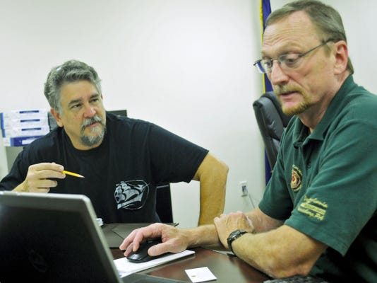 Terry Gendron, right, meets with U.S. Navy veteran Mark Katona, of Carlisle, on Tuesday in Shippensburg. Gendron recently began hosting office hours in Shippensburg to expedite contact with the Veterans Administration to help military veterans gain benefits or make claims.