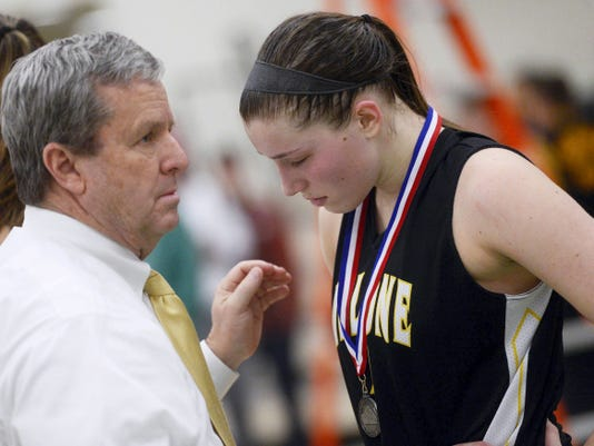 Delone Catholic head coach Gerry Eckenrode consoles Maggie Comly after giving her a runner-up medal after the Squirettes lost the YAIAA girls' basketball championship game at York College on Thursday. West York beat Delone Catholic, 47-35.
